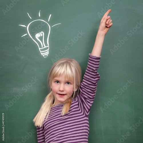 Schoolgirl at the Blackboard with Idea