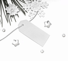 Blank gift tag tied with a silver decoration