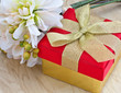 Festive gift box on wooden background