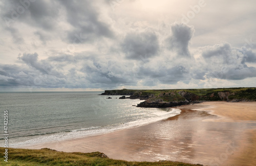 Broad Haven, Pembrokeshire, under a stormy sky.