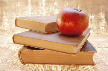 Fresh red apple on a books