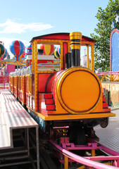 A Childrens Train Ride at a Fun Fair.