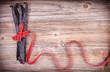 Red ribbon wraped around vanilla pods