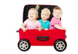 Group of kids driving in travel suitcase car