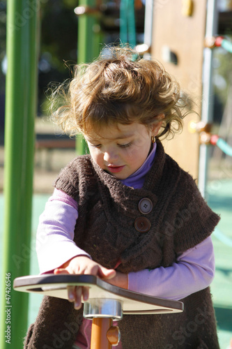 Young girl playing in a playground