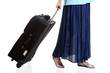 Woman travelling with luggage concept