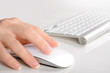 Woman's  hands using mouse and keyboard