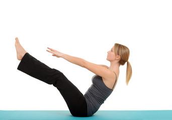 Woman doing Pilates teaser pose