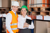 Confident Young Supervisors At Warehouse poster