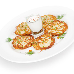 potato pancakes with smoked salmon and sour cream. isolated on w
