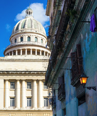 The capitol of Havana and a crumbling building