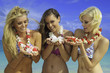 three friend in bikinis with flowers