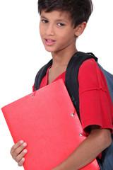 Schoolboy holding a folder