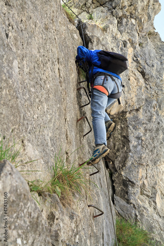 Sass de Rocia, Italy  - climber on via Ferrata