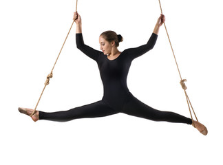 Young woman gymnast on rope