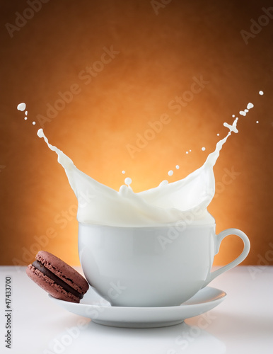 cup of milk splash with macaron