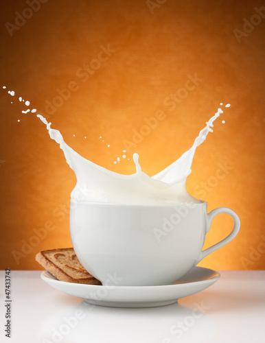 cup of milk splash with biscuit