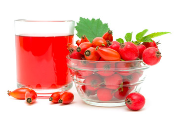rose hips, hawthorn and drink on a white background