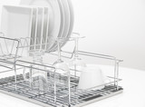 Dishes and glasses drying on metal dish rack