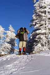 Hiker in winter mountains snowshoeing