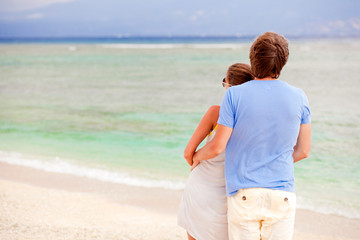 beautiful young couple looking on the horizon. honeymoon