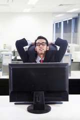 Businessman relax in front of computer at office