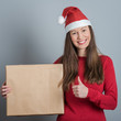 Young smiling santa woman holding gift
