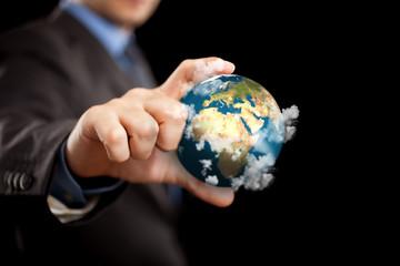 Businessman holding the world