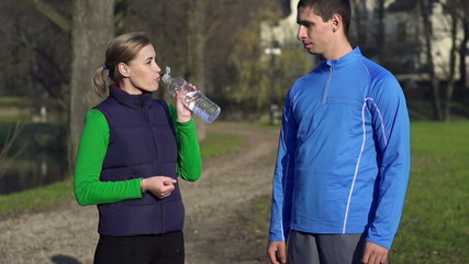 Joggers drinking water after workout, slow motion,shot at 120fps