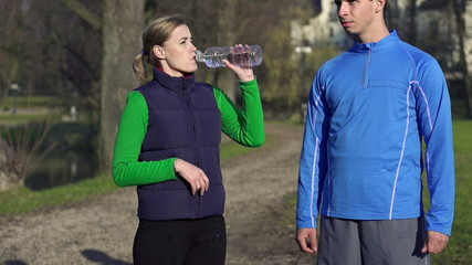 Joggers drinking water after workout, slow motion,shot at 240fps