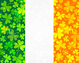Vector Irish flag background made from green and orange clovers