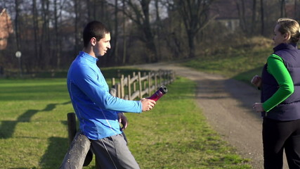 Man giving bottle to jogger, super slow motion, shot at 240fps