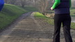 Couple jogging in park, crane shot, slow motion, shot at 240fps