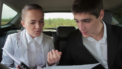 Young business people arguing in the car