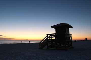 Lifegaurd station on Siesta Key, Florida at sunset