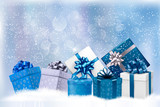 Fototapety Christmas blue background with gift boxes and snowflakes. Vector