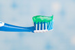 toothbrush against blue tile background