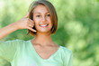 young woman talking on phone simulates