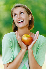 smiling beautiful young woman with red apple