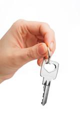hand holding key isolated on white