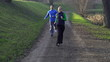 Happy couple jogging in the park, crane shot, slow motion
