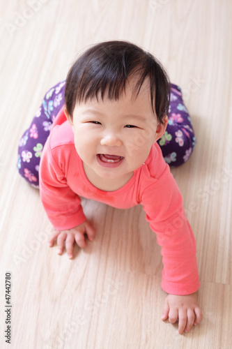 crawling baby girl smile