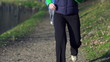 Tired woman catching breath during jogging, super slow motion