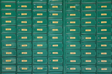 Green post boxes at post office
