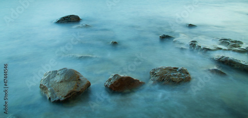 Seascape with rocks near sunset