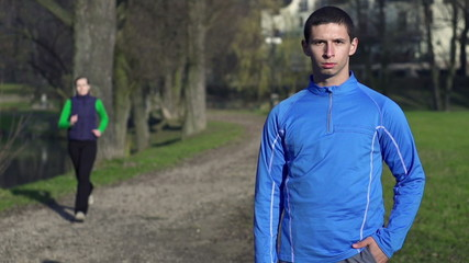 Portrait of young jogger in park, crane shot