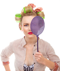 Funny housewife / girl with fly swatter, isolated on white