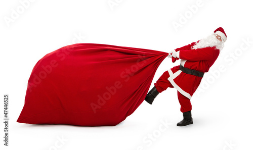 Leinwanddruck Bild Santa Claus with huge bag full of presents isolated