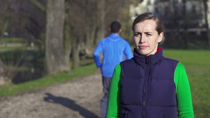 Portrait of young female jogger in park, crane shot
