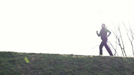 Woman jogging in park, super slow motion, shot at 480fps